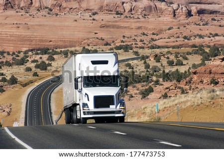 Semi truck on difficult road in Utah, USA - stock photo