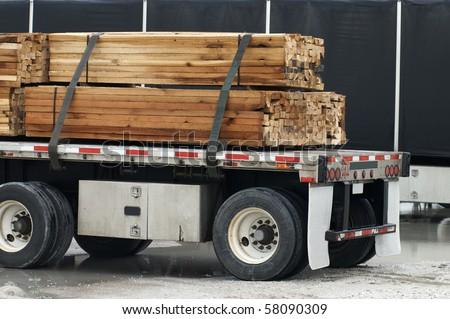 Semi with wood load - stock photo