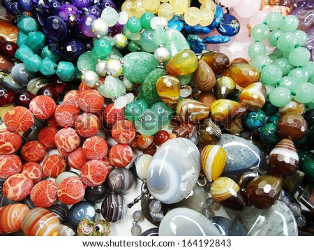 semiprecious beads made of geological minerals - stock photo