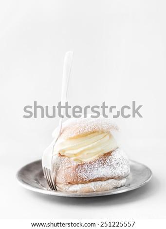 Semla, traditional Scandinavian cream bun. Typically eaten in Sweden in February. - stock photo