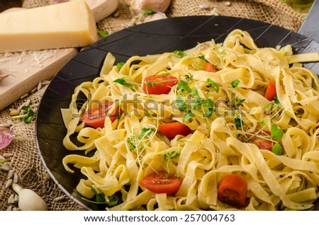 Semolina pasta with roasted garlic, sprinkled microherbs, fresh and tasty, garlic baked in the oven - delicious - stock photo