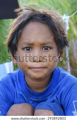 SEMPORNA, SABAH, MALAYSIA - JUNE 6: Portrait ofSea Gypsies boy on June 6th, 2014 in Semporna Island, Sabah Malaysia.  - stock photo