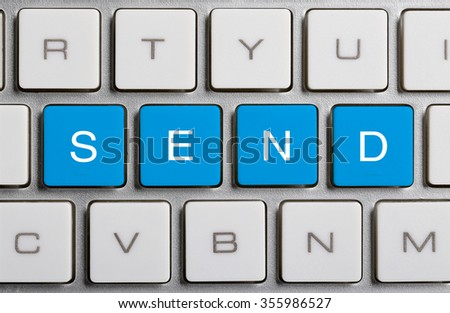 SEND text on the colorful buttons of the keyboard. - stock photo