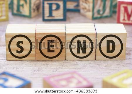 SEND word written on wood cube - stock photo