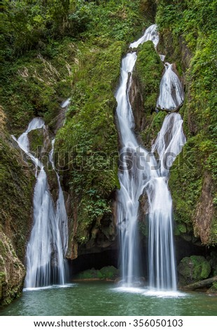 Sendero Vegas Grande waterfall. Waterfall in a lush rainforest. Vegas grande waterfall in Topes de Collante, Trinidad, Cuba  - stock photo