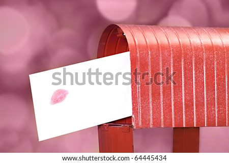 Sending a love letter with a big kiss on the envelope - stock photo