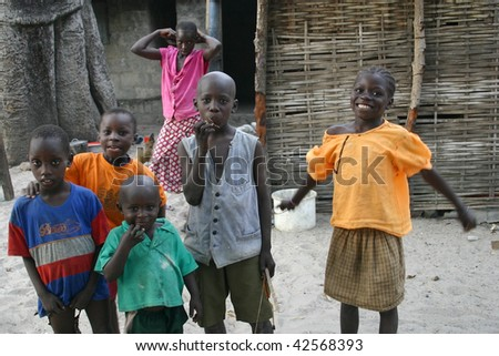SENEGAL - Febreo 18: Children Diola happy with the visit of the tourists, are scarce resources and tourism is an important source of revenue, in February 18,2007 in Carabane, Senegal - stock photo