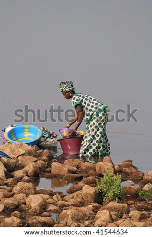 SENEGAL - FEBRUARY 14: African woman comes to wash into the river, the villages have no running water, February 14, 2007 in Country Bassari, Senegal. - stock photo