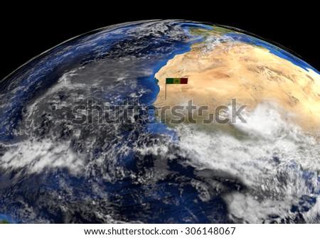 Senegal flag on pole on earth globe illustration - Elements of this image furnished by NASA - stock photo