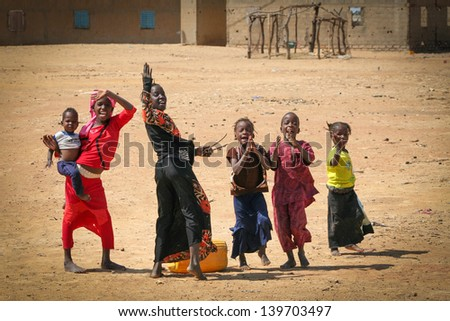 SENEGAL - MAY 2: Unidentified young Senegal girls saluting in the middle of Senegal, on May 2, 2011. Despite poverty, Senegal kids stay smiling. - stock photo
