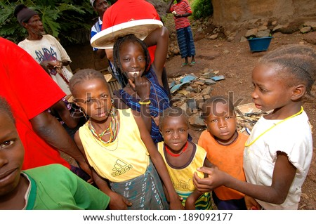 SENEGAL - SEPTEMBER 17: Kids from the Bedic ethnicity, the Bedic living on the margins of society on top of a hill, on September 17, 2007 in Country Bassari, Senegal - stock photo