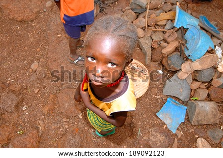 SENEGAL - SEPTEMBER 17: Little girl from the Bedic ethnicity, the Bedic living on the margins of society on top of a hill, on September 17, 2007 in Country Bassari, Senegal - stock photo
