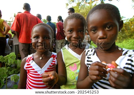 SENEGAL - SEPTEMBER 17: Little unidentified girls from the Bedic ethnicity, the Bedic living on the margins of society on top of a hill, on September 17, 2007 in Country Bassari, Senegal  - stock photo