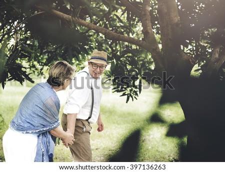 Senior Adult Couple Love Romance Nature Park Concept - stock photo
