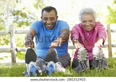 Senior African American Couple Exercising In Park - stock photo