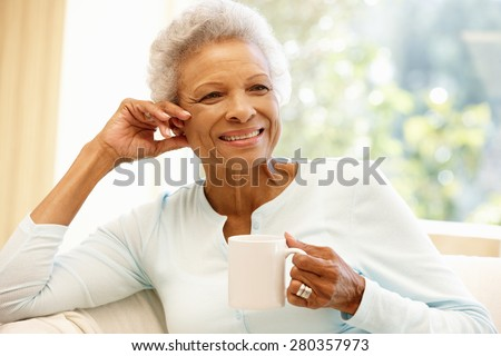 Senior African American woman at home - stock photo