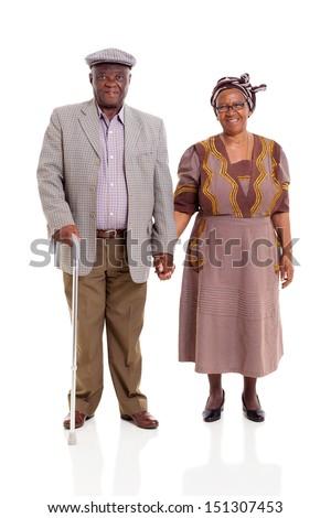 senior african couple holding hands on white background - stock photo