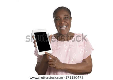 Senior african woman with tablet PC, Studio Shot - stock photo