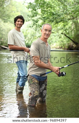 senior and junior angling - stock photo