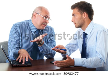 senior and junior businessman discuss and argue over something during their meeting, isolated on white - stock photo