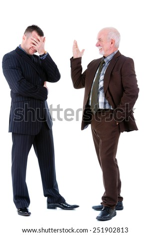 Senior and junior handsome business people discussing. Isolated - stock photo