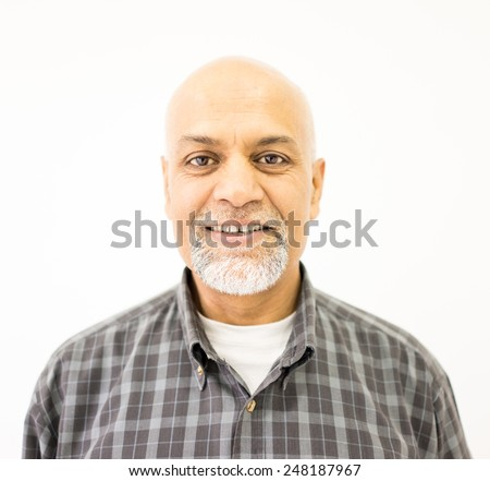 Senior Arabic Pakistani man studio portrait - stock photo