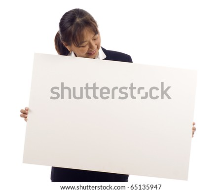 Senior Asian American business woman holding blank billboard, and looking at it isolated over white background - stock photo