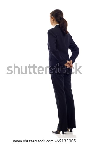 Senior Asian business woman from the back - looking at something over a white background - stock photo