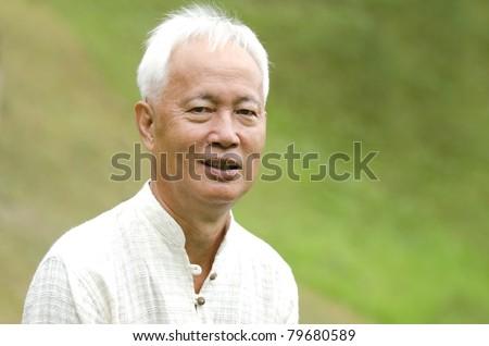 senior asian man outdoor portrait - stock photo