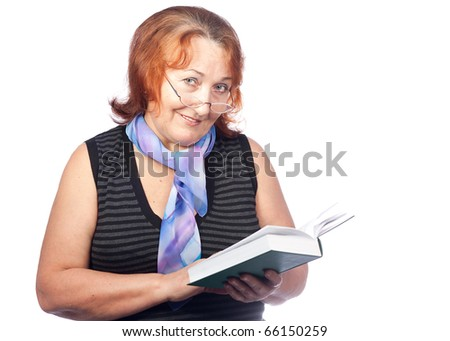 Senior beautiful woman is reading a book - stock photo
