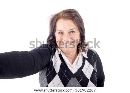 senior beautiful woman talking a selfie - stock photo