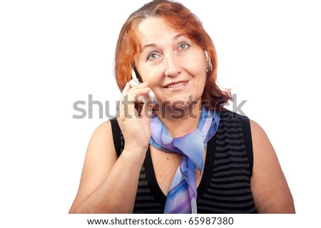 Senior beautiful woman talking on a mobile phone - stock photo