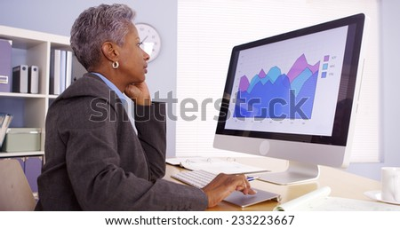 Senior black businesswoman working in office - stock photo