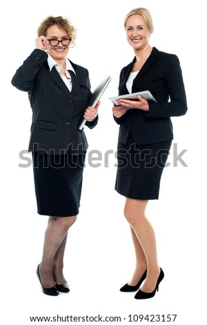 Senior business executives exploring business ideas. All on white background - stock photo