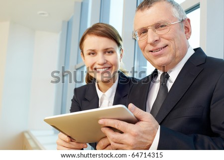 Senior business leader with happy businesswomen on background - stock photo