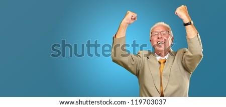 Senior Business Man Cheering Isolated On Blue Background - stock photo