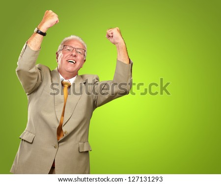 Senior Business Man Cheering Isolated On Green Background - stock photo