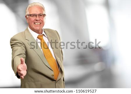 Senior Business Man Offering Handshake, Indoor - stock photo