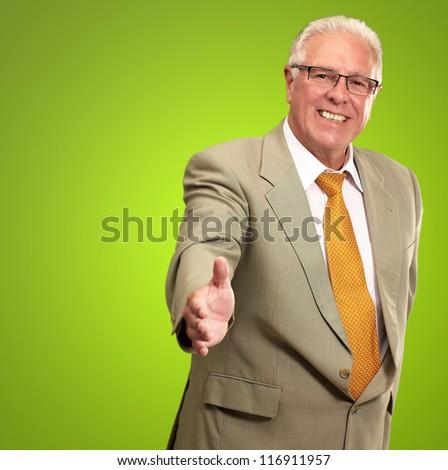 Senior Business Man Offering Handshake Isolated On Green Background - stock photo