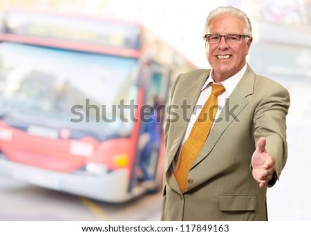 Senior Business Man Offering Handshake, Outdoor - stock photo