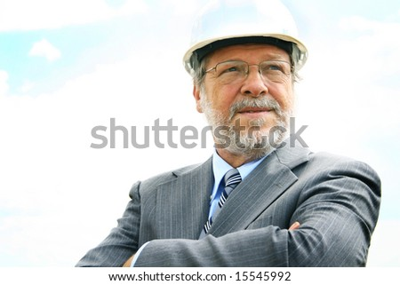 Senior business man with white hard hat - stock photo