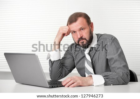 Senior business man working on laptop - stock photo