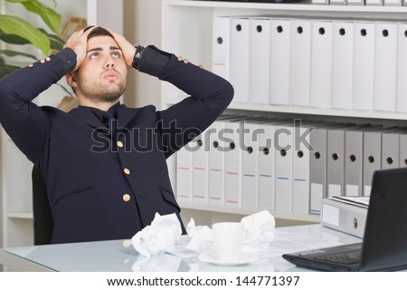 Senior business person  sitting at office desk looking up and being frustrated  from too much work - stock photo