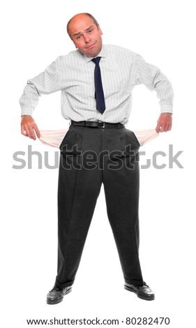 Senior businessman bankrupt, his hands with two empty pockets. - stock photo