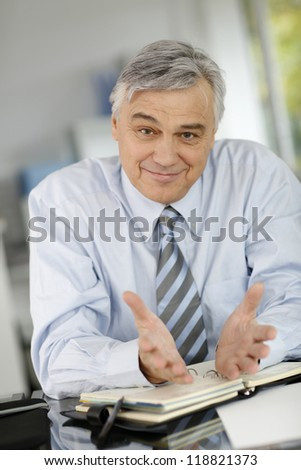 Senior businessman meeting client in office - stock photo
