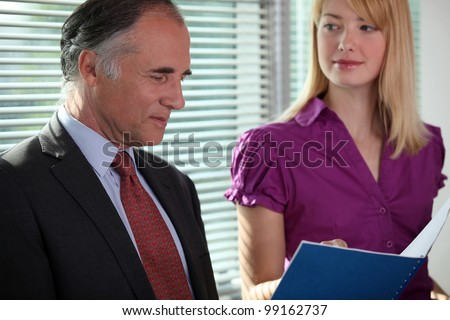 senior businessman reading a report - stock photo