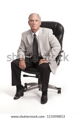 Senior Businessman sitting in chair - stock photo