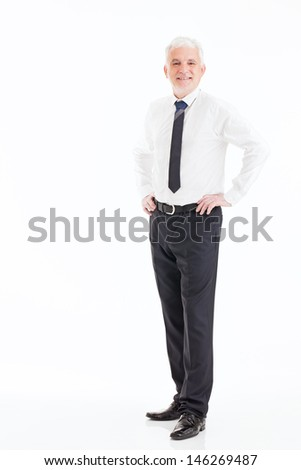 Senior businessman smiling and posing in front of a white background. - stock photo