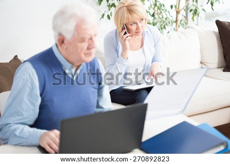 Senior businesspeople working together at home - stock photo