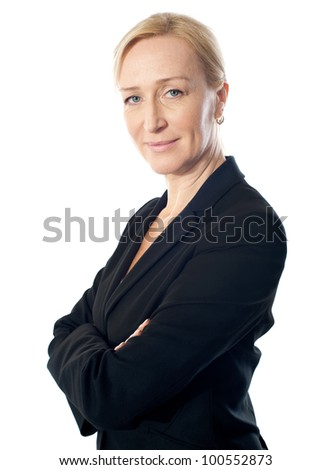 Senior businesswoman posing with folded arms, closeup shot. Isolated on white - stock photo